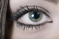 Green eye close up of a young woman s horizontal shoot Royalty Free Stock Photography