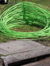 Green fiber optic cable piled in front of residential housing at suburb of Noble Park Royalty Free Stock Photo