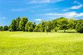 Green field and beautiful blue sky. european landscape Royalty Free Stock Photo