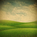 Green field and blue sky vintage nature background Stock Images