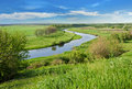 Green field, river and blue sky Royalty Free Stock Photo