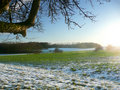 Green field and snow Royalty Free Stock Images