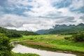 Green field stream curve Royalty Free Stock Photo