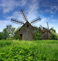 Green field with a windmill Royalty Free Stock Photos
