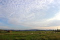Green fields cloudy sky and Royalty Free Stock Photography