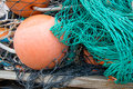 Green Fishing Nets with Orange Buoy Float Royalty Free Stock Photo