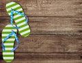 Green flip flop sandals on wooden boards