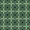 Green floral abstract background. Seamless pattern with symmetric geometric ornament. Royalty Free Stock Photo