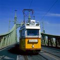 The green Freedom Bridge, with yellow tram Royalty Free Stock Image