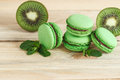 Green french macarons with kiwi and mint decorations