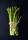 Green Fresh Asparagus On Black...