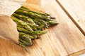 Green fresh asparagus on a wooden table Stock Image