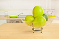Green fruits in modern kitchen on a plate a clean Royalty Free Stock Image