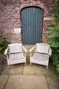 Green garden door garden seats england uk walled wood Royalty Free Stock Images