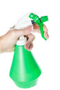 Green garden plastic foggy sprayer bottle in hand cleaning equipment object isolated on white background without shadows Stock Images