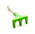 Green garden rake Royalty Free Stock Photo
