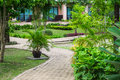 Green garden in the resort walkway among a Royalty Free Stock Images