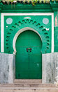 Green gate of ancient mosque in medina tangier morocco Royalty Free Stock Photos