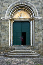 The green gate in corniglia yellow old church of italy Royalty Free Stock Photos
