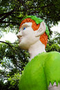Green giant elf sculpture with ginger hair smiling pointy eared guards miniature golf course Stock Photography