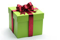 Green gift box with red ribbon and bow Stock Photo