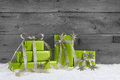 Green gift boxes for christmas on grey shabby background. Royalty Free Stock Photo