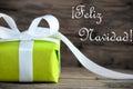 Green Gift with Feliz Navidad Royalty Free Stock Photo