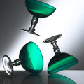 Green glas wine glases with a grey backround falling to the ground Stock Photos