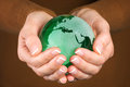 Green Glass globe in hand Royalty Free Stock Photo