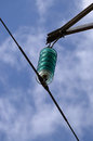 Green glass insulators electrical against blue sky and white clouds Stock Photography