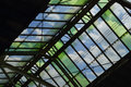 Green glass roof detail of train station over blue sky, Bangkok Royalty Free Stock Photo