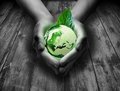 Green glass world in the heart hand Royalty Free Stock Photo