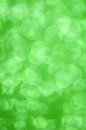 Green glitter christmas abstract background defocused lights Royalty Free Stock Photos