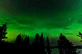 Green glow of Northern Lights or Aurora borealis Stock Image