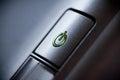 Green glowing power button. Closeup Royalty Free Stock Photo