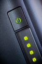 Green glowing power button. Closeup Royalty Free Stock Photo