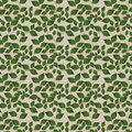 Green and gold leaf pattern various sized leaves edged in along a vine elegant off white checkered background Stock Image