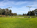 Green golf field and blue cloudy sky. american landscape Royalty Free Stock Photo