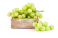 Green grapes in wooden box isolated on white backgroun Royalty Free Stock Photos