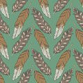 Green graphic illustration seamless boho and ethno pattern with natural eagle feathers and arrows on green background