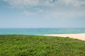 Green grass with beach in west island of taiwan Royalty Free Stock Image