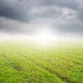 Green grass fields and rainclouds for outdoor background Stock Photos