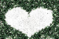 Green grass frame sand in heart shape Royalty Free Stock Photo