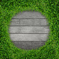 Green grass frame and vintage wood background. Royalty Free Stock Photo