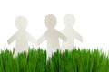 Green grass and Paper Chain men Royalty Free Stock Photo
