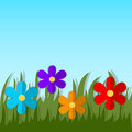 Green grass with paper flowers