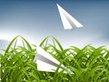 Green Grass and paper plane Stock Image