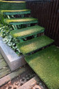 Green grass staircase in garden, interior decoration Royalty Free Stock Photo