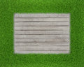 Green grass on wood floor background realistic Stock Image