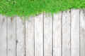 Green grass and wood plank natural background lawn texture as Stock Image